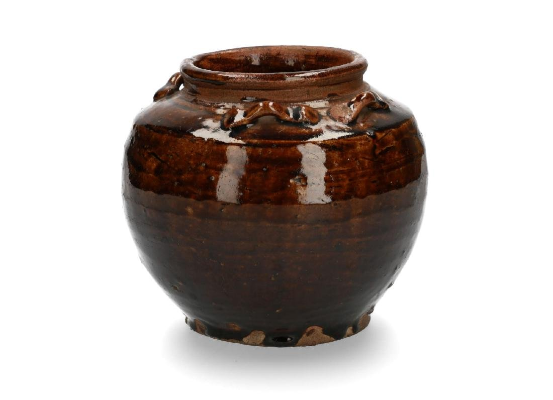 A brown glazed stoneware Martaban storage jar. China, - 2