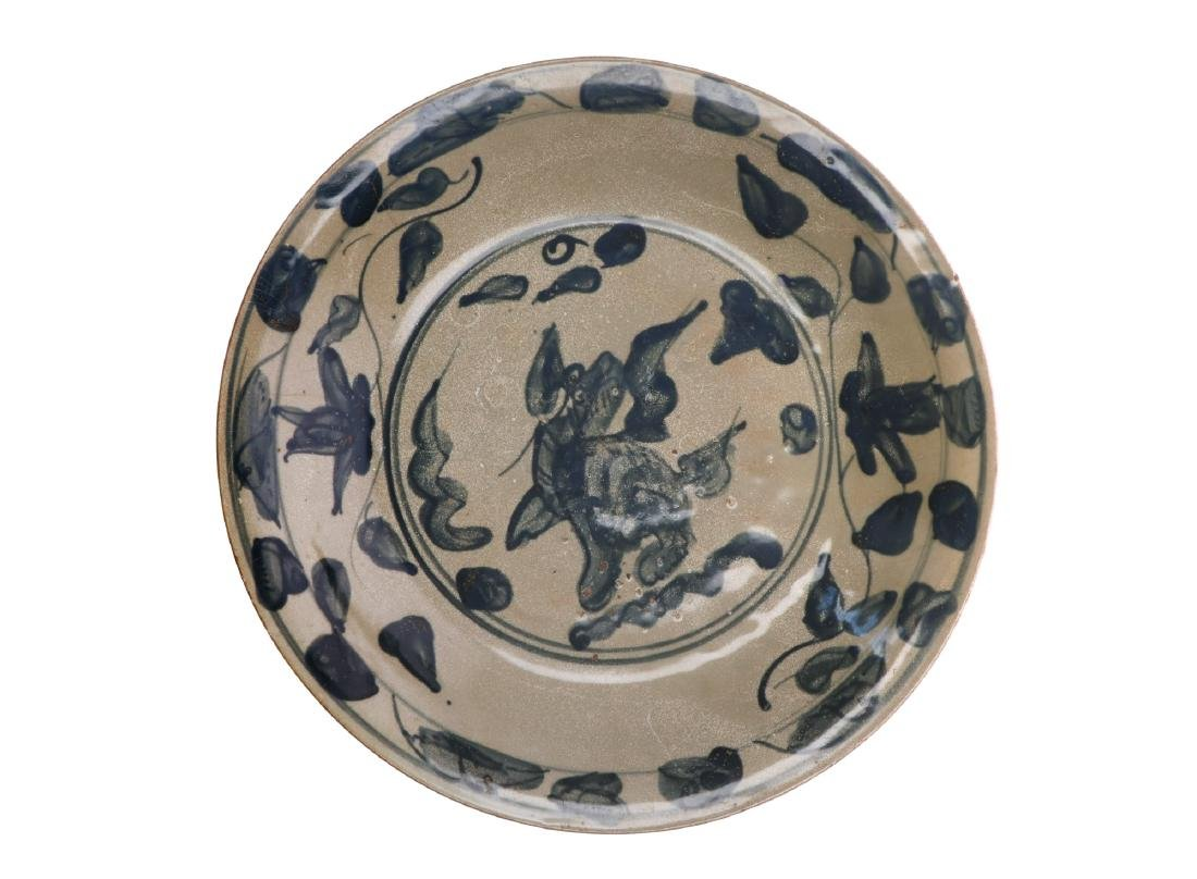 A large Swatow charger decorated with a Qilin to the