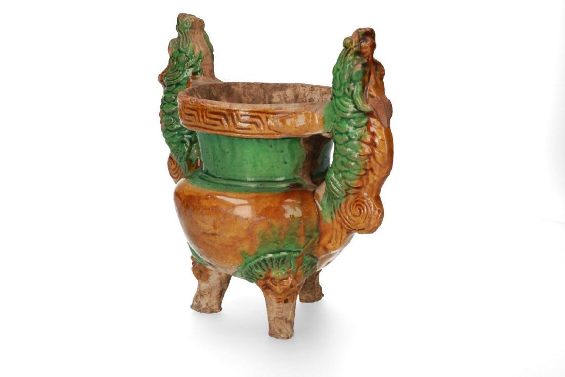 A pottery double dragon sancai glazed tripod incense