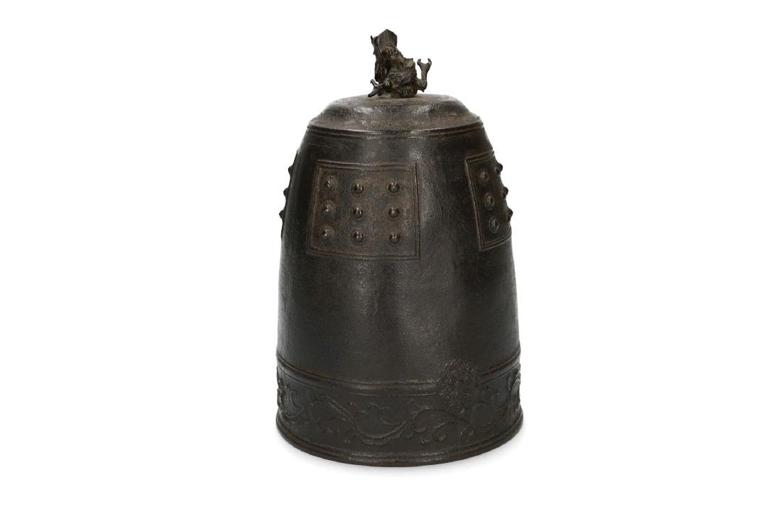 A bronze dome shaped Bo bell decorated with a frieze