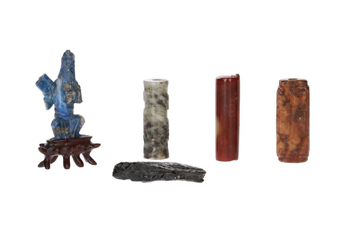 A diverse lot of: a rough obsidian stone (6 cm), an