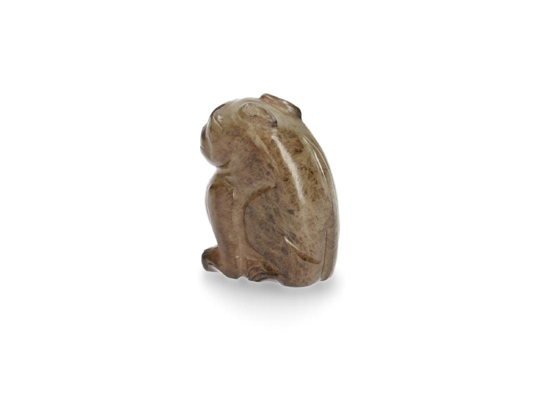A nephrite jade buddhist lion. The animal is plainly