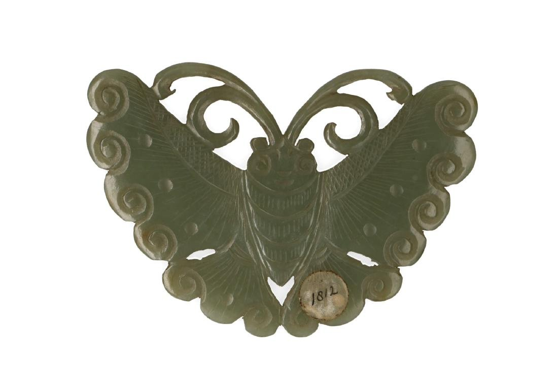 A jade plaque carved in the shape of a butterfly.