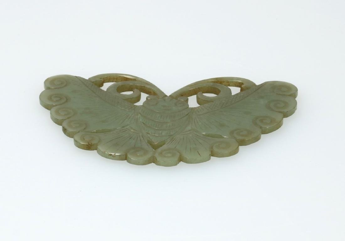 A jade plaque carved in the shape of a butterfly. - 2
