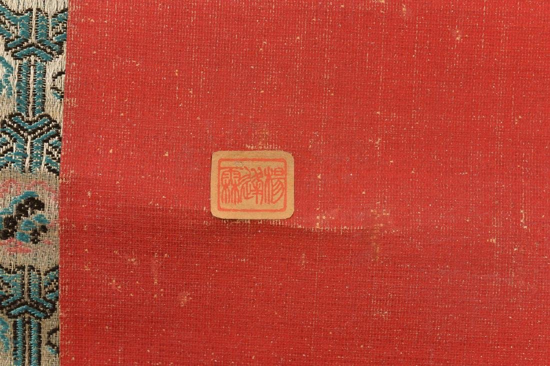 A red silk paper hanging scroll with sitting Lohan. - 3