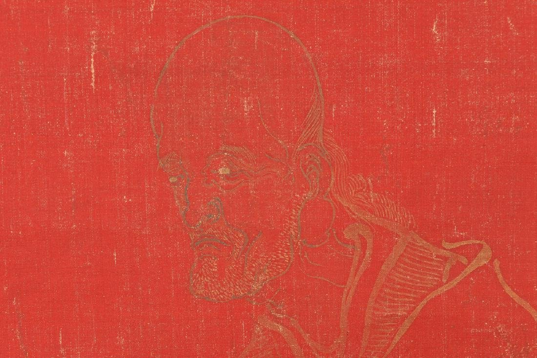 A red silk paper hanging scroll with sitting Lohan. - 4