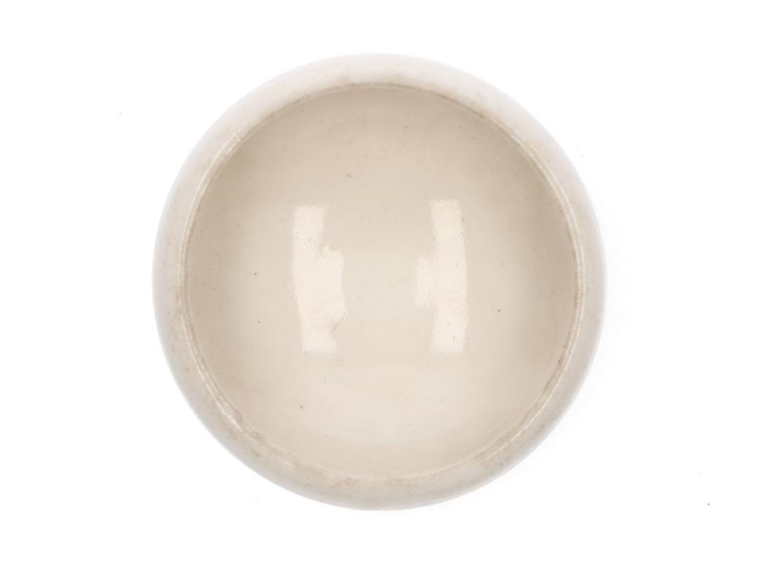 A white porcelain brush washer with a narrowing rim. - 2