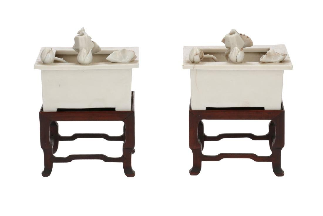 A pair of Dehua Blanc-de-Chine porcelain lamps in the