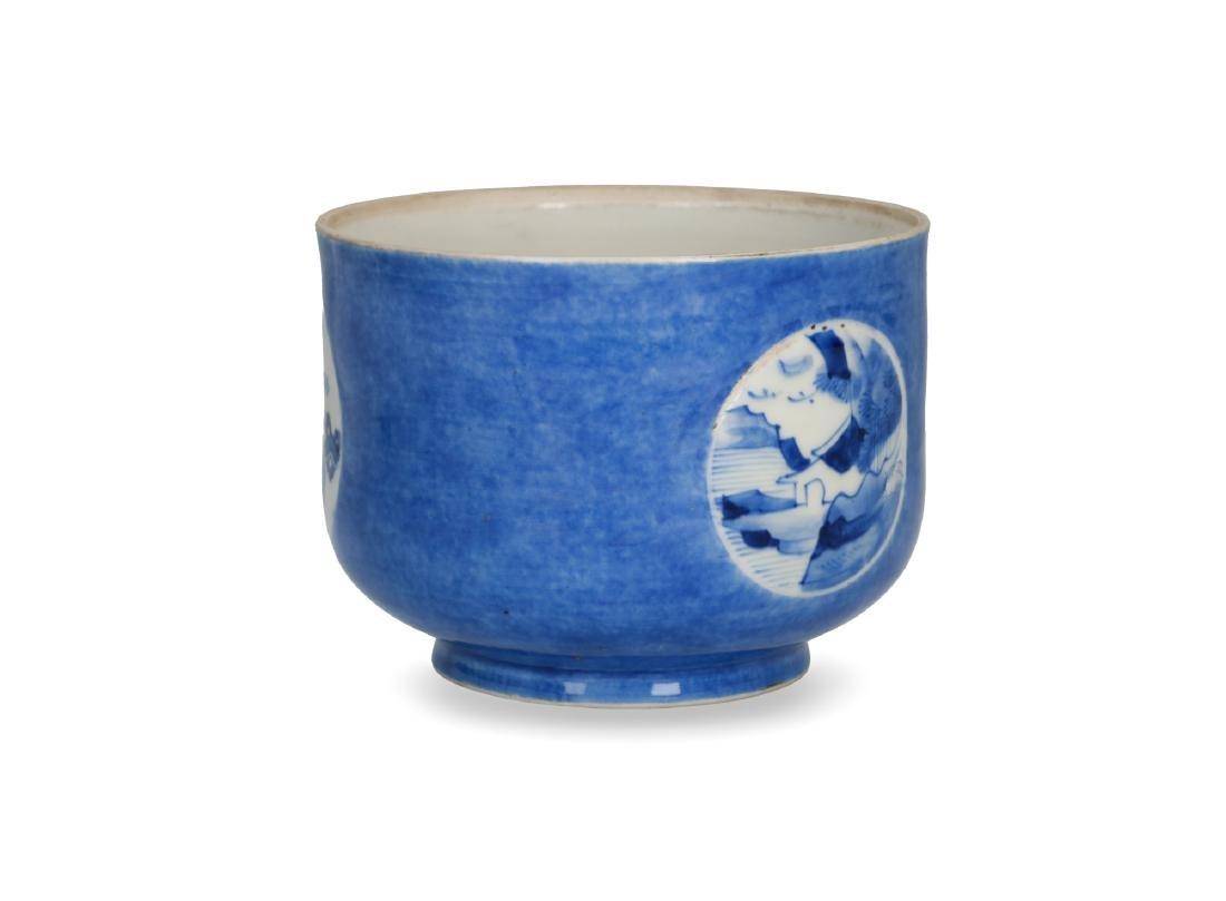 A powder blue jar with circular reserves with a decor