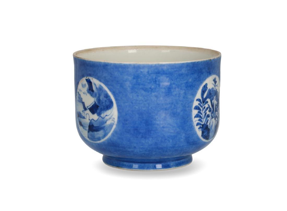 A powder blue jar with circular reserves with a decor - 2