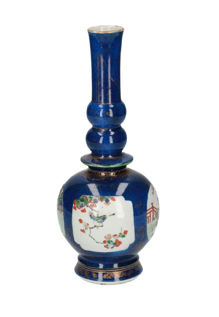 A powder blue porcelain bottle neck vase. The body with