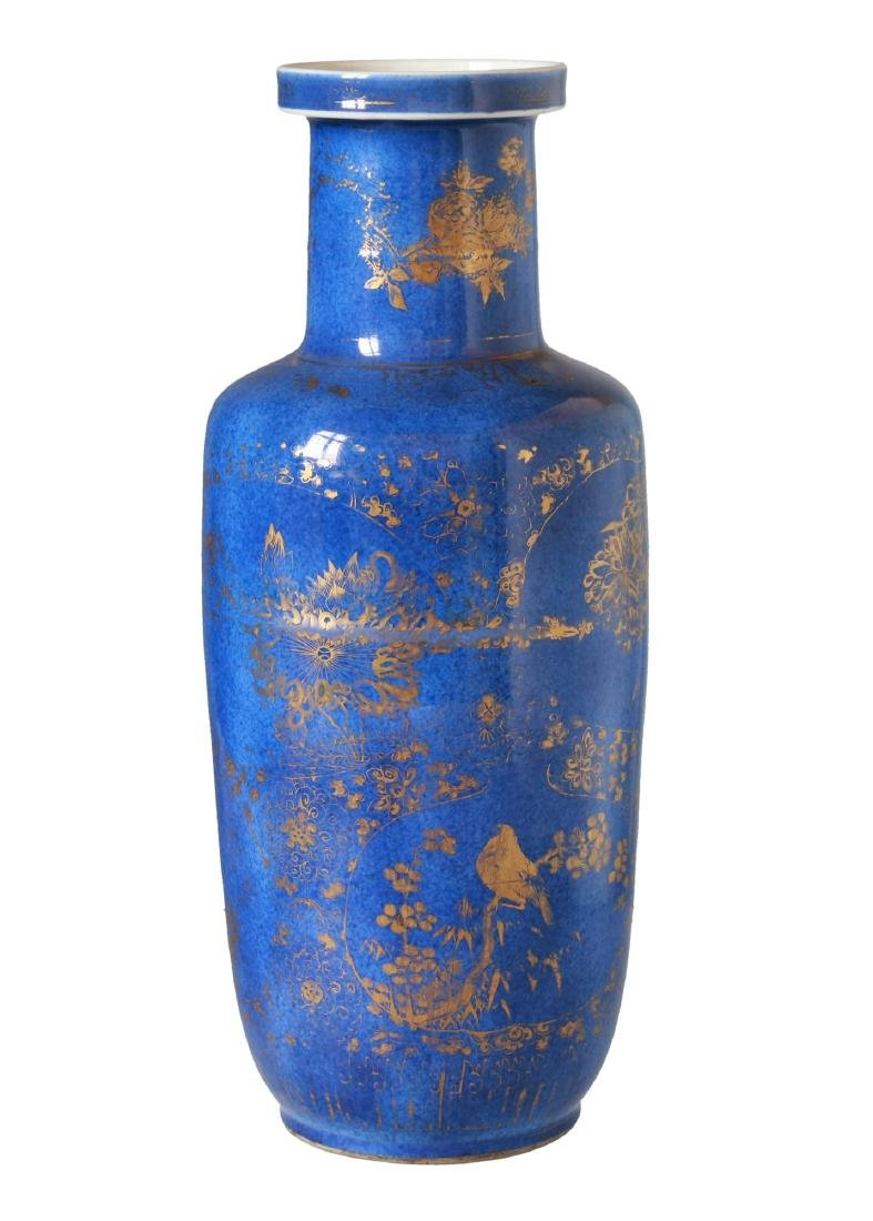 A powder blue and gilt porcelain rouleau vase. The very