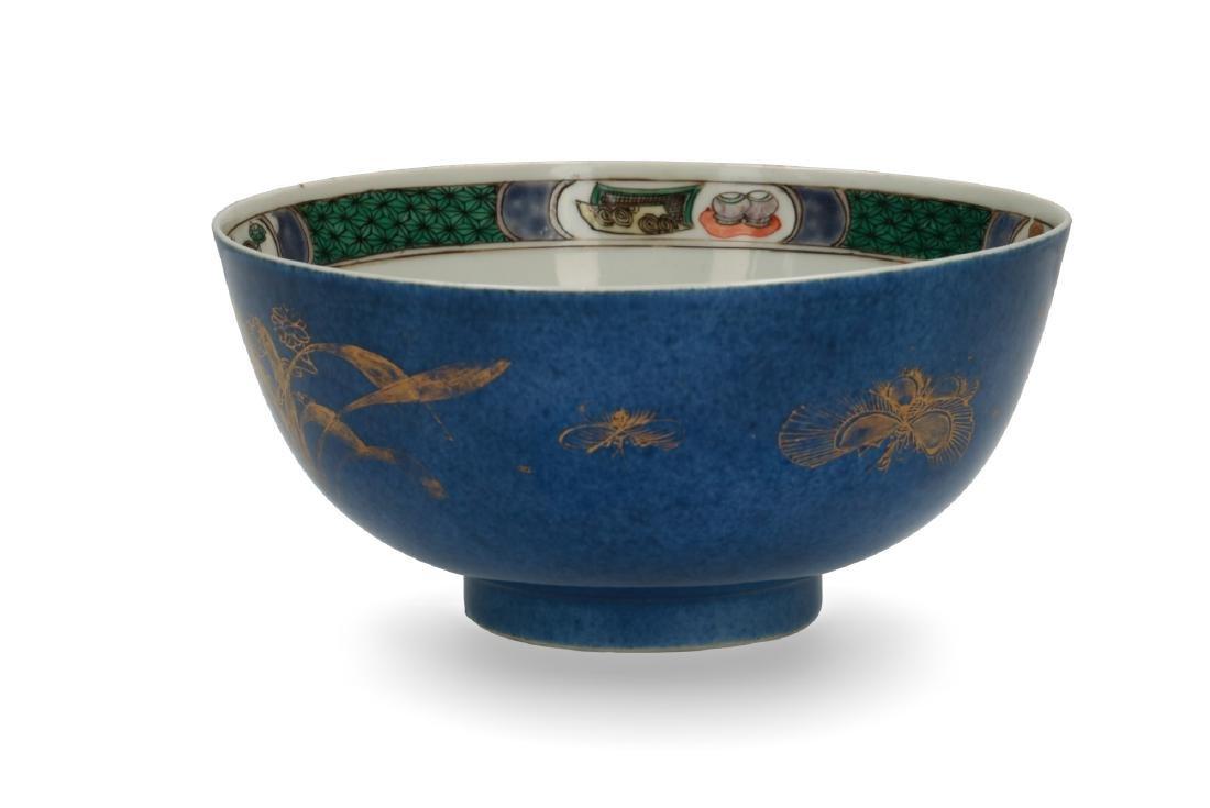 A powder blue and gilt porcelain Famille Verte bowl.