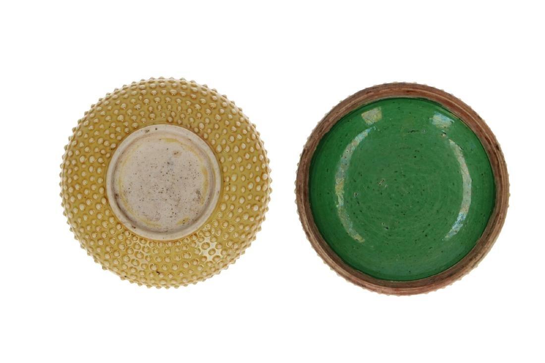 A polychrome porcelain lidded circular box with a - 4