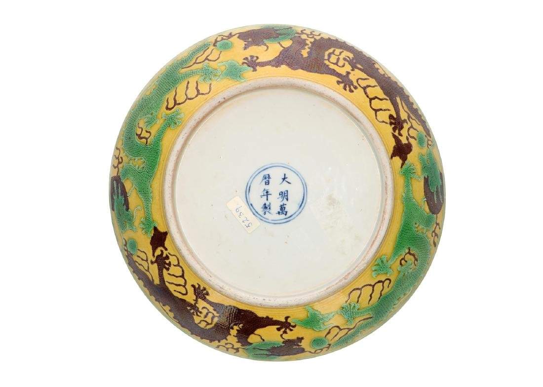 A Sancai porcleain deep dragon dish with a carved and