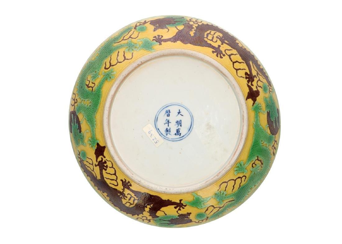 A Sancai porcleain deep dragon dish with a carved and
