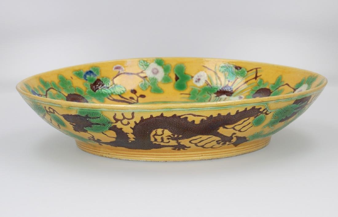 A Sancai porcleain deep dragon dish with a carved and - 2