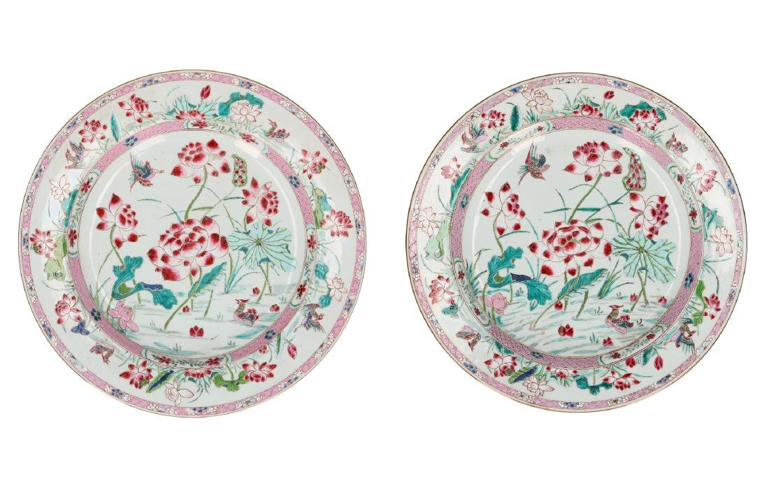 A rare pair of large Famille Rose chargers with a decor