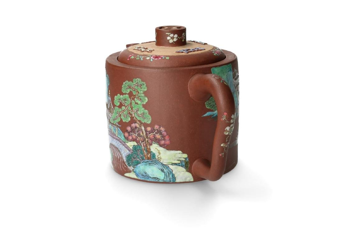 A rare Yixing teapot with on one side a polychrome