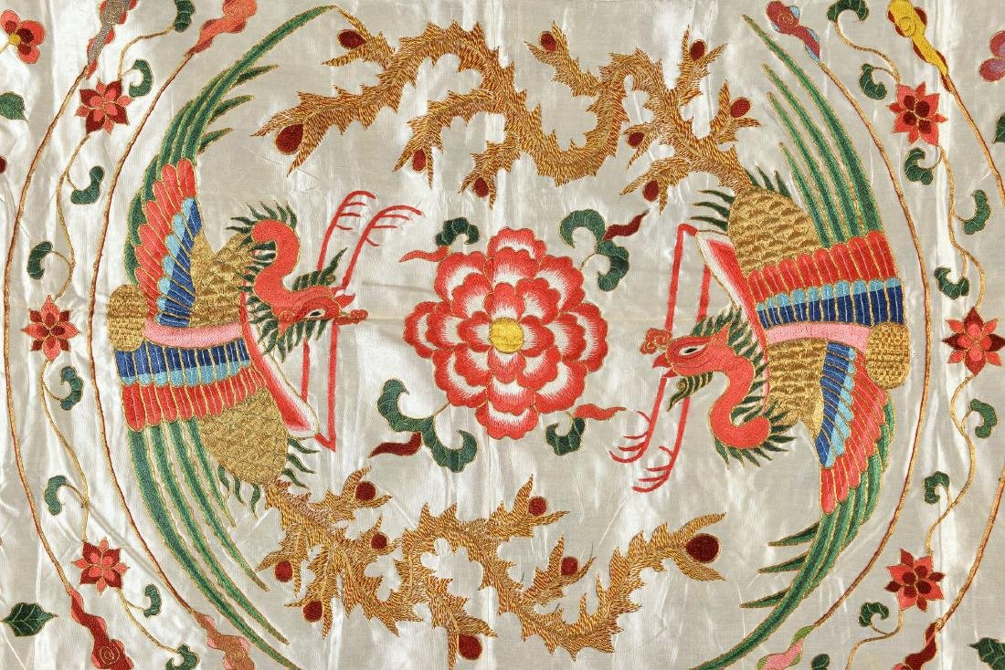 A multi colored silk cloth decorated with phoenixes,