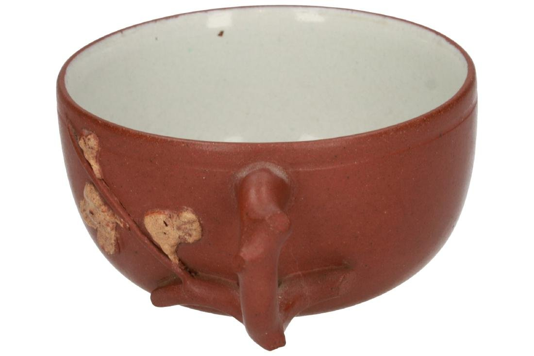 A Yixing cup decorated with branch in relief. Unmarked.