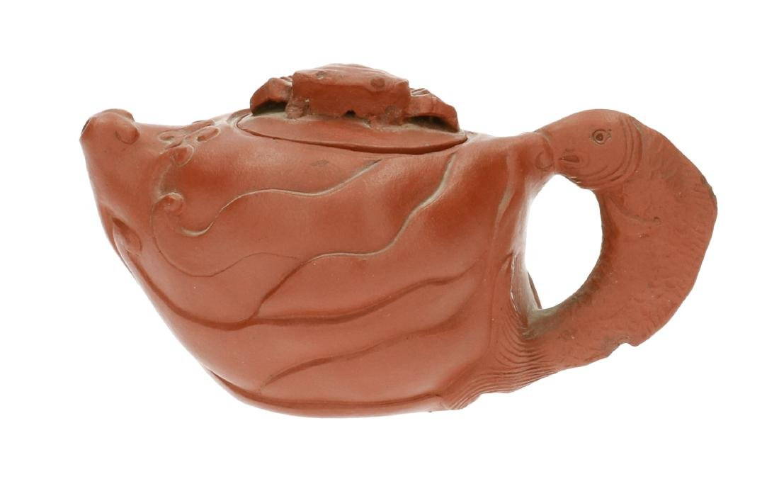 A Yixing teapot with handle in the shape of a fish and