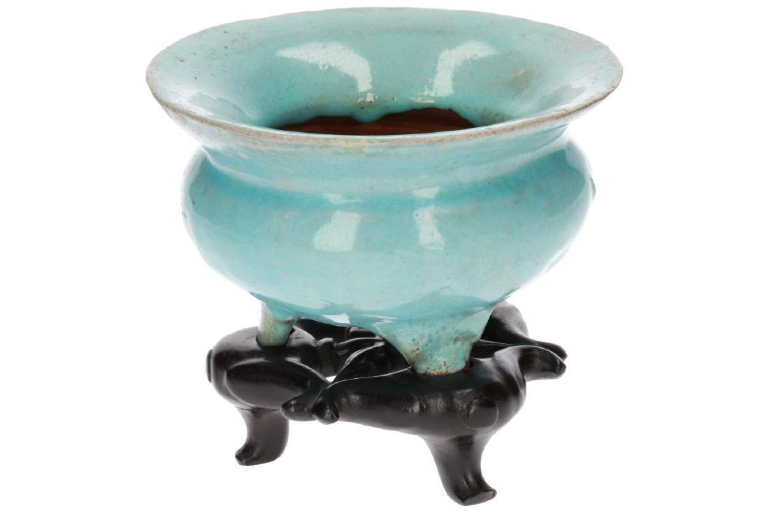 A turquoise glazed stoneware tripod censer on wooden - 3
