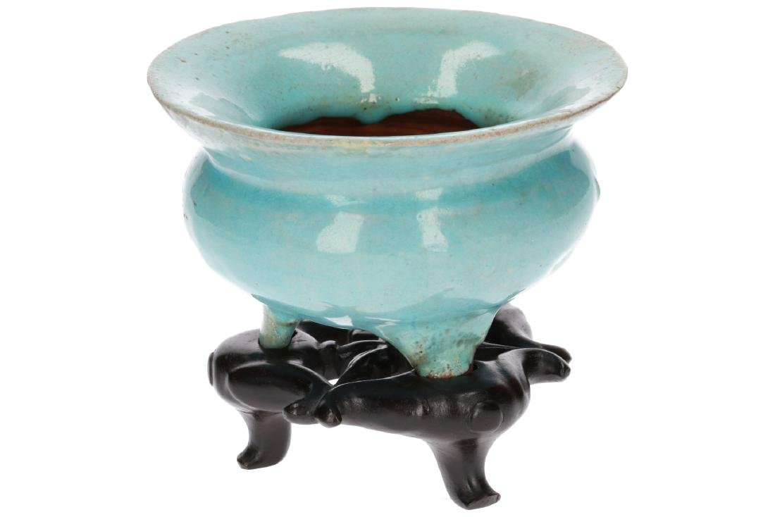 A turquoise glazed stoneware tripod censer on wooden - 3
