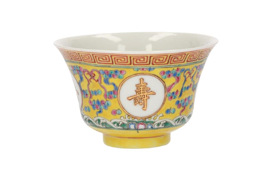 A polychrome porcelain bowl, decorated with characters