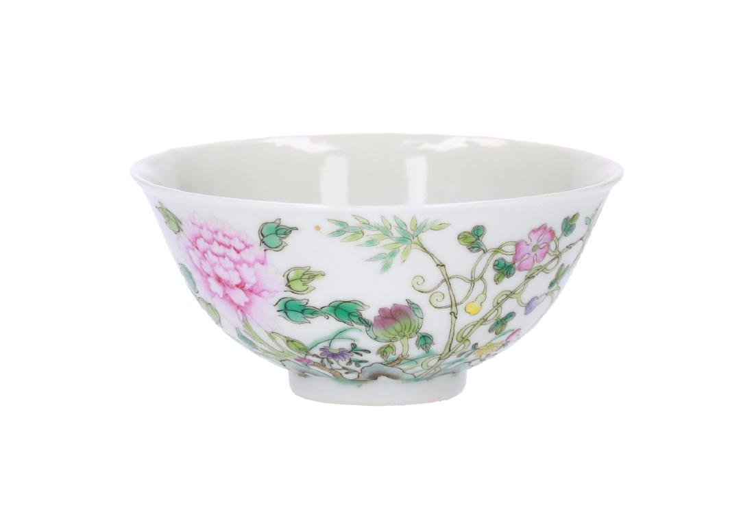A polychrome porcelain bowl, decorated with flowers.
