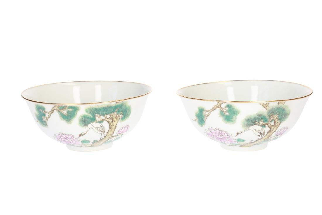 A pair of polychrome porcelain bowls, decorated with