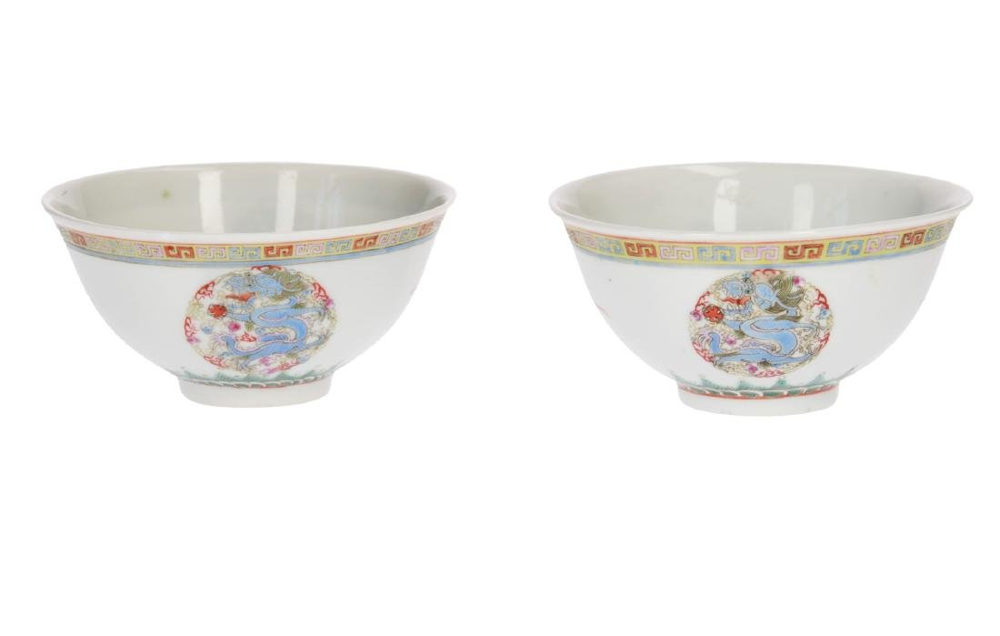 A pair of polychrome porcelain cups, decorated with