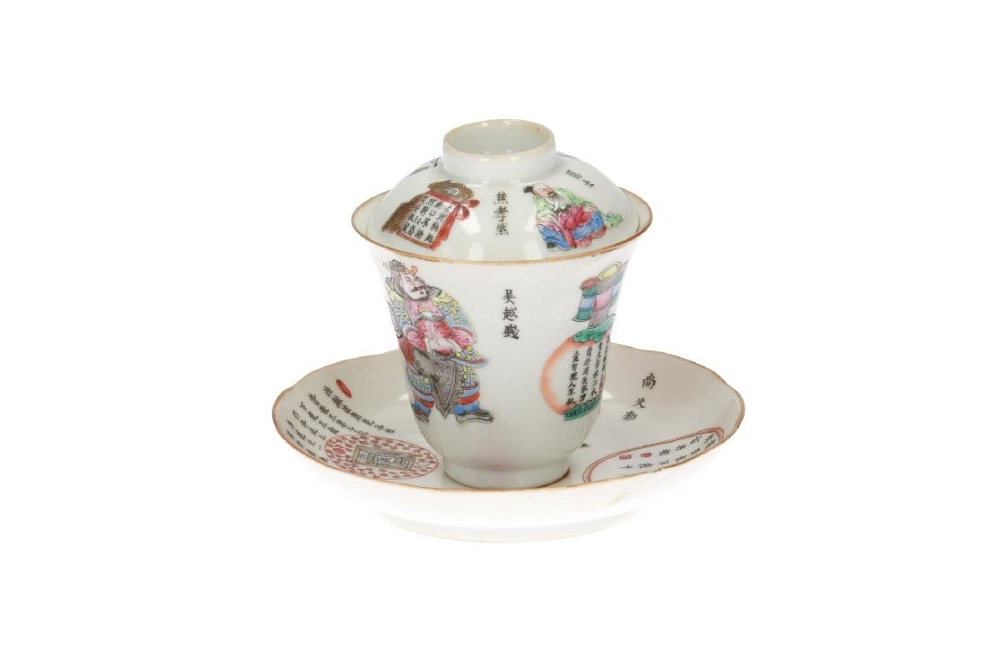 A polychrome porcelain lidded cup with saucer,