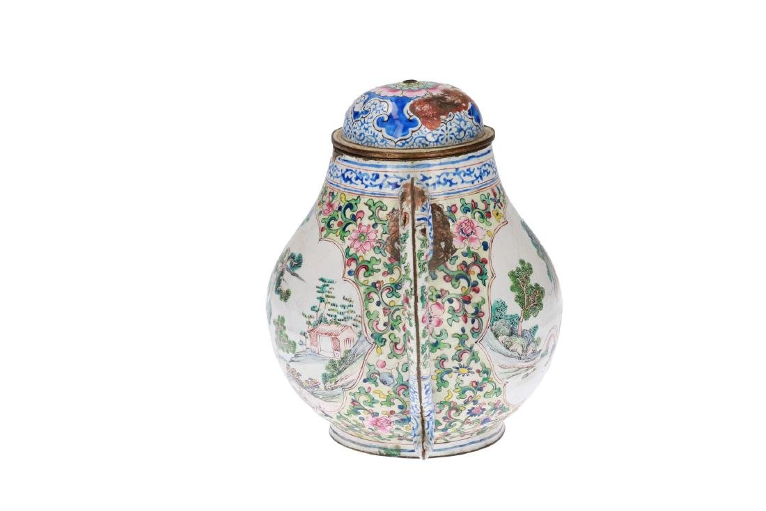 A metal with enamel teapot decorated with mountainous