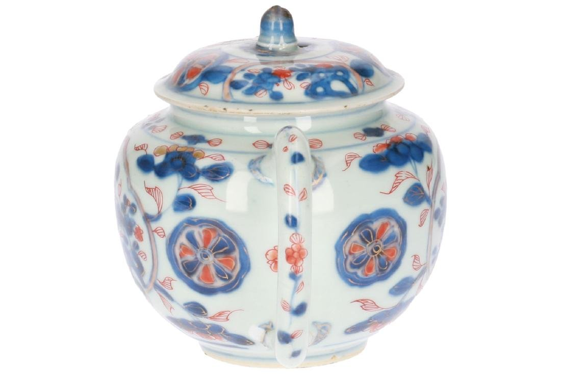 A lot of two polychrome porcelain teapots, 1) Imari, - 2