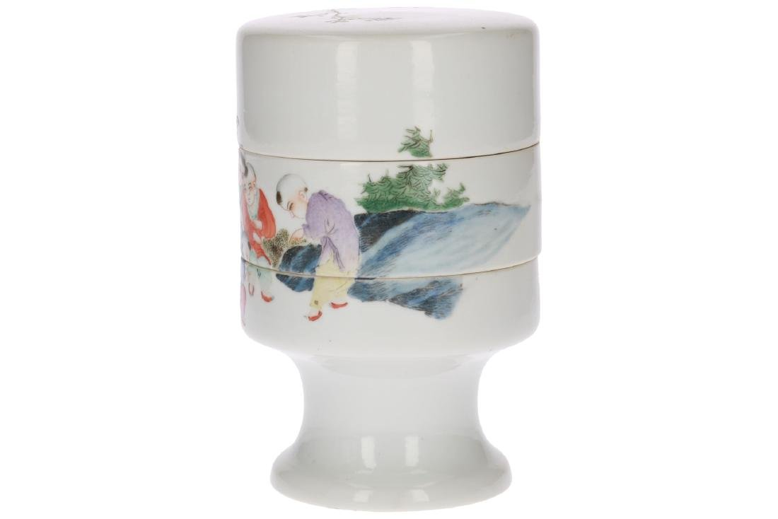 A polychrome porcelain three-story candy jar, decorated