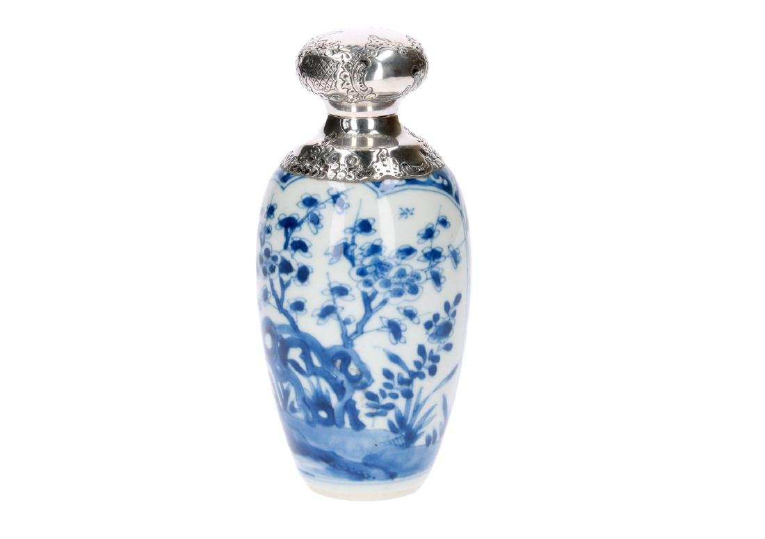 A blue and white porcelain tea caddy with floral decor.