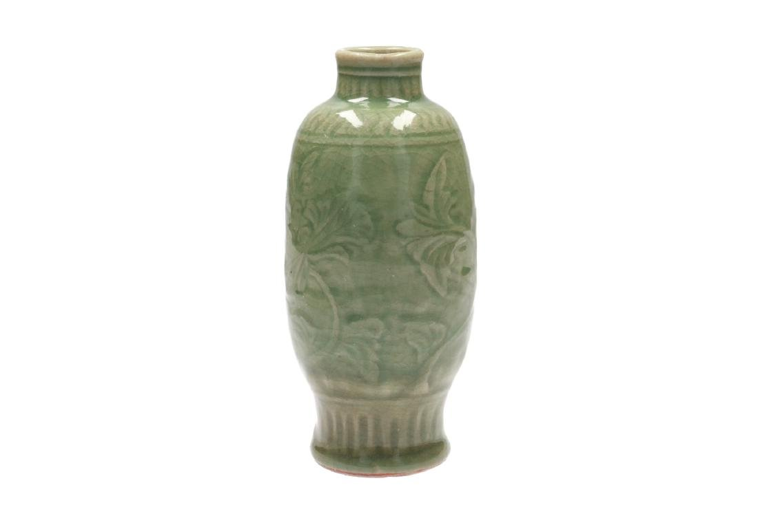 A Longquan celadon glazed vase with floral decor.