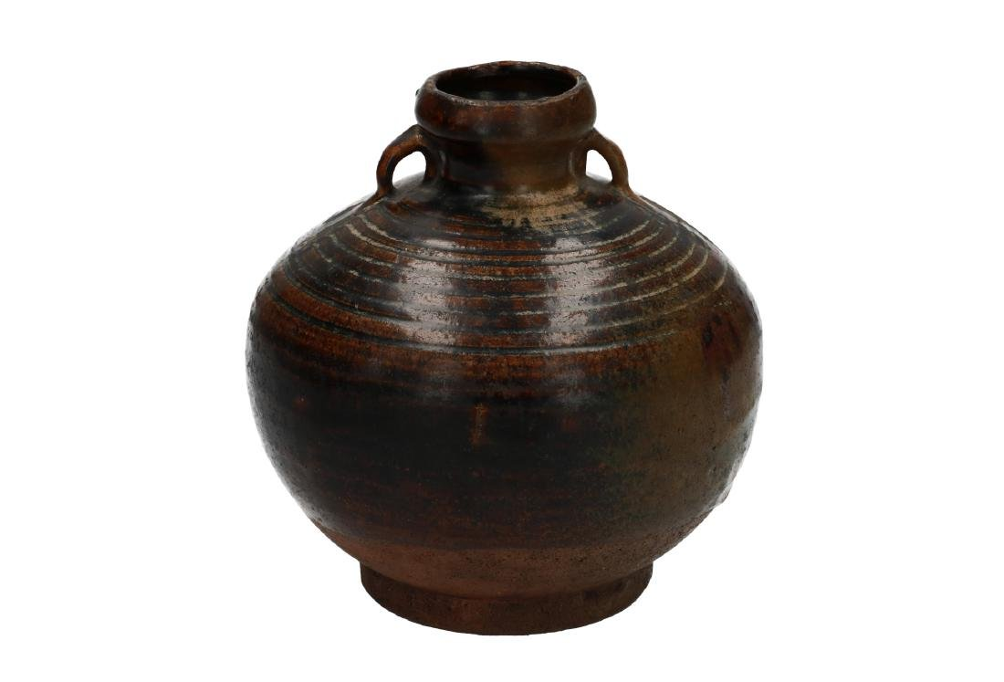 A brown glazed ceramic vase with grips, with horizontal