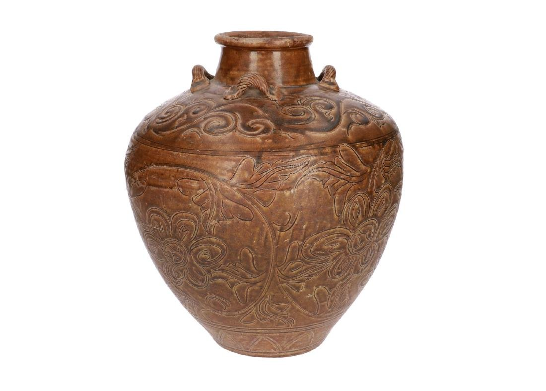 A brown glazed stoneware Martavan with four grips, with