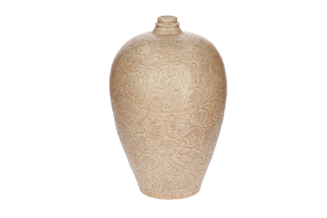 A gray-white glazed yingqing Meiping vase with carved
