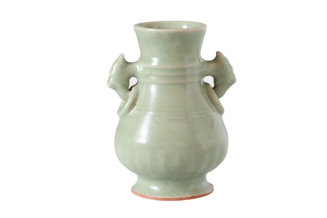 A celadon green glazed porcelain vase with handles.