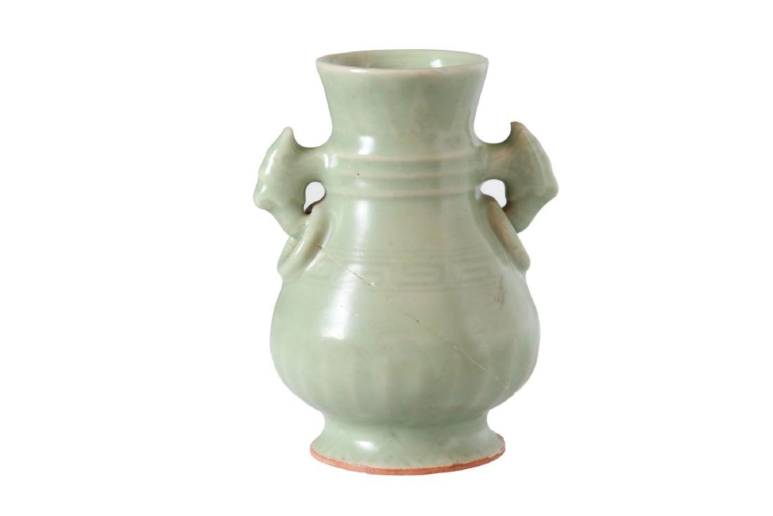 A celadon green glazed porcelain vase with handles.