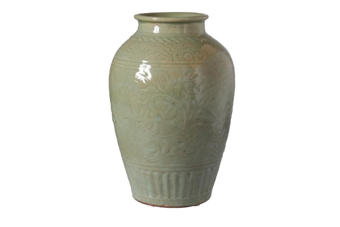 A green glazed celadon vase with relief decor of - 2
