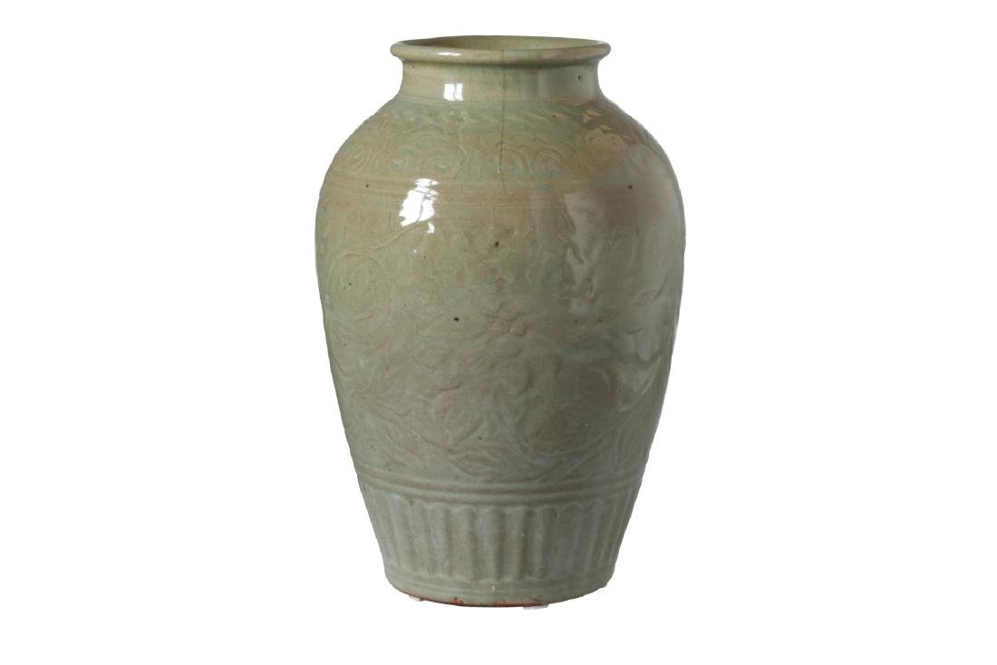 A green glazed celadon vase with relief decor of - 3