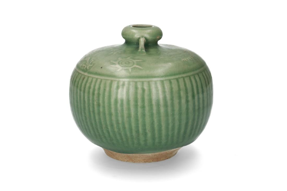 A green glazed celadon vase with decor of vertical