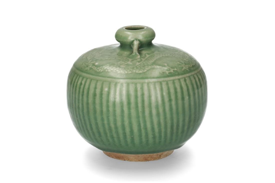 A green glazed celadon vase with decor of vertical - 3