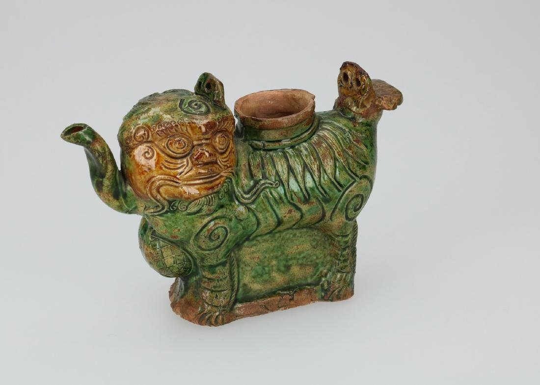 An earthenware 'sancai' lion in the shape of a teapot.