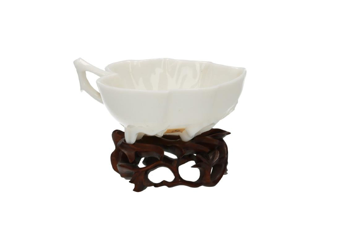 A Blanc-de-Chine porcelain cup with wooden stand, both - 2