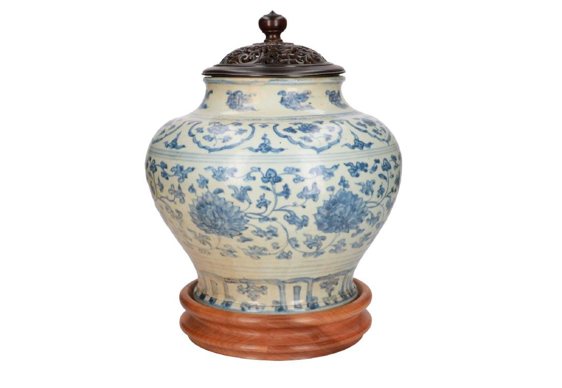 A blue and white porcelain vase with floral decor.